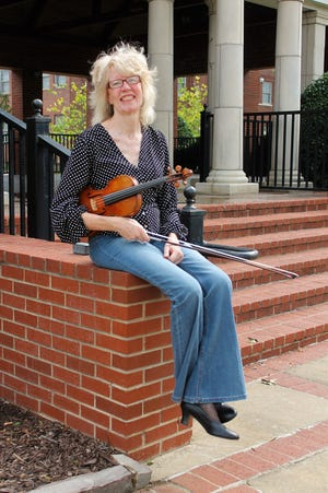 Lori Fay, founder and director of A String Fort Smith.
