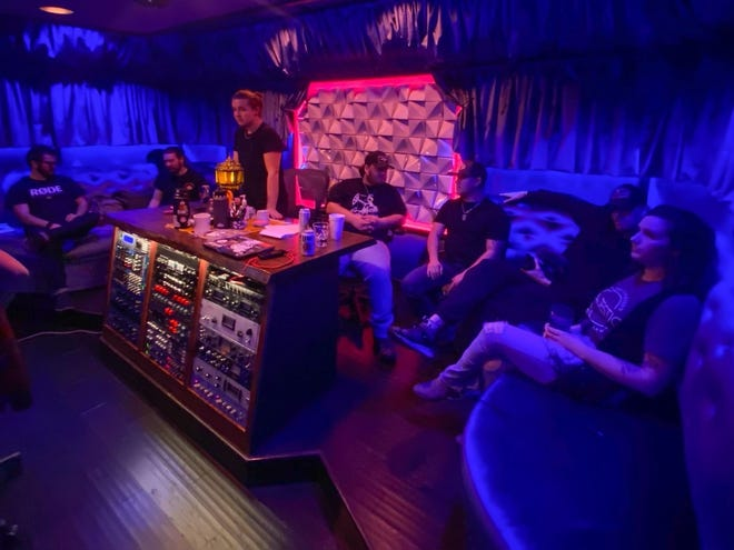 Members of SŌL Studios, The Majestic and Peacemaker Festival sit with Tanner Usrey's band during Usrey's time recording an EP at the studio.