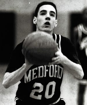 Former MHS boys' basketball player Brian Skerry is shown concentrating on a free throw attempt during the Feb. 15, 1993 game.