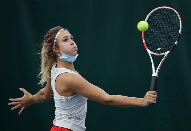 Neenah's Ava Dunsirn hits a shot against Appleton East during their girls tennis match March 17 at Valley Fitness and Racquet in Neenah.