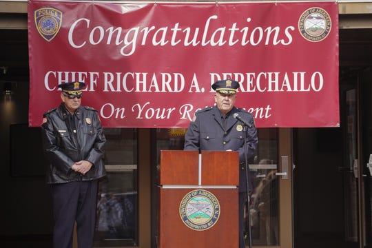New Aberdeen police chief Alan Geyer, center, speaks while outgoing chief Rick Derechailo watches