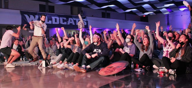Abilene Christian fans packed into the Abilene Convention Center cheer the Wildcats' first basket against UCLA in Monday's NCAA Tournament second-round game.