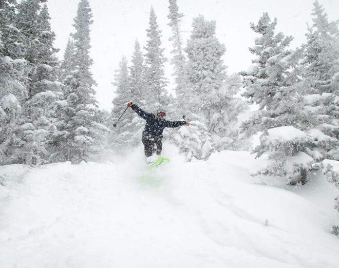 A skier enjoys fresh powder on Sunday, March 14, 2021, at Eldora Mountain Resort near Nederland, Colo.
