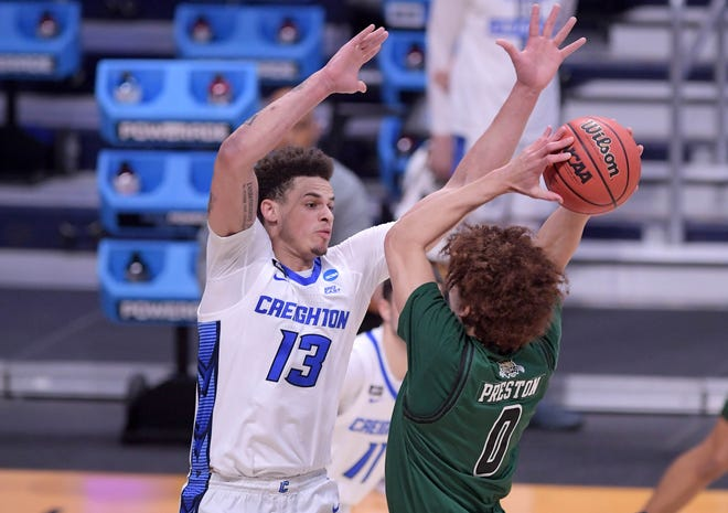 Creighton Bluejays forward Christian Bishop (13) blocks Ohio Bobcats guard Jason Preston (0) during the second round of the 2021 NCAA Tournament on Monday, March 22, 2021, at Hinkle Fieldhouse in Indianapolis, Ind.