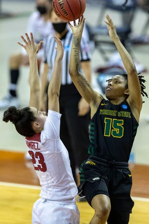 Wright State guard Angel Baker (15) scores over Arkansas guard Amber Ramirez (23) during the first half of a college basketball game in the first round of the women's NCAA tournament at the Frank Erwin Center in Austin, Texas, Monday, March 22, 2021.