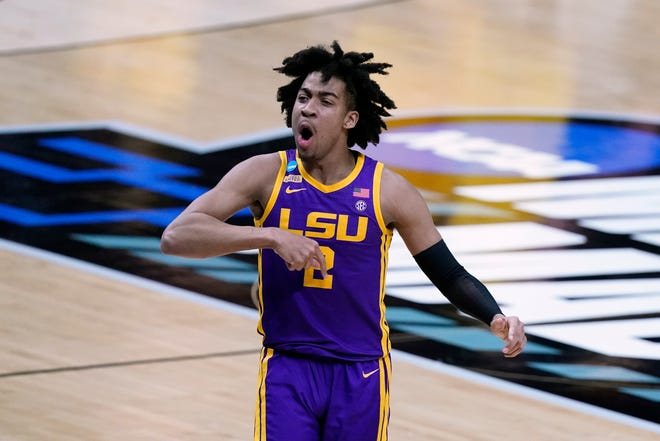 LSU forward Trendon Watford celebrates after making a basket during the first half of a second-round game against Michigan in the NCAA men's college basketball tournament at Lucas Oil Stadium Monday, March 22, 2021, in Indianapolis. (AP Photo/Darron Cummings)