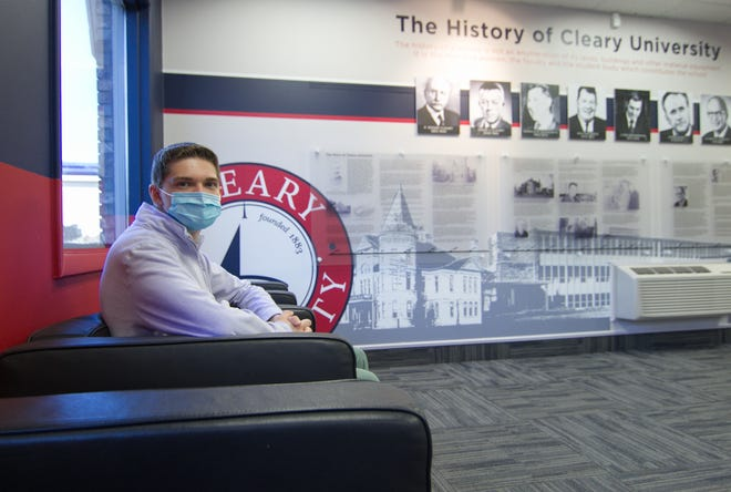 Ben Hibbard sits in the lobby of Chrysler Hall at Cleary University Monday, March 22, 2021. Hibbard is earning an associate degree this spring through Cleary's Early College Program.
