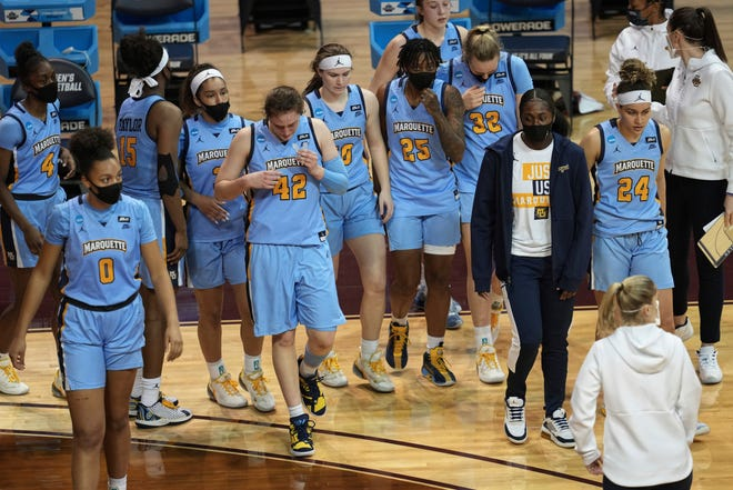 Marquette players and coaches walk off the court after their loss to Virginia Tech in the first round of the NCAA tournament.