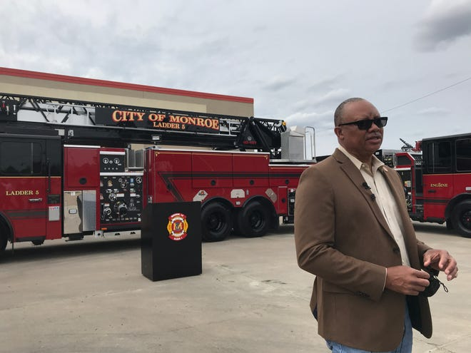 Monroe Fire Department Chief Terry Williams talks about a 107' aerial ladder truck added to the fleet on Monday at the Public Safety Center.