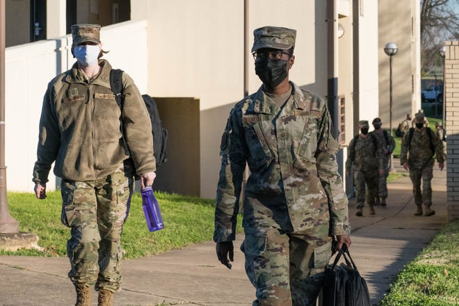 Senior Noncommissioned Officer Academy students walk to class March 4, 2021, on Maxwell Air Force Base's Gunter Annex. After nearly a year of only virtual classes, SNCOA welcomed back its first in-residence class this month.