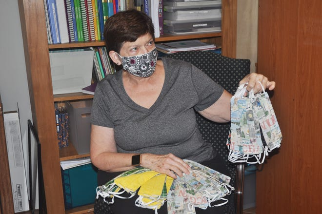 Mary Jane Spirk sorts through the masks she is about to send to Sea Gate Elementary School. Spirk and some other ladies at St. William Catholic Church have made more than 2,000 masks to donate to the school and other local organizations.