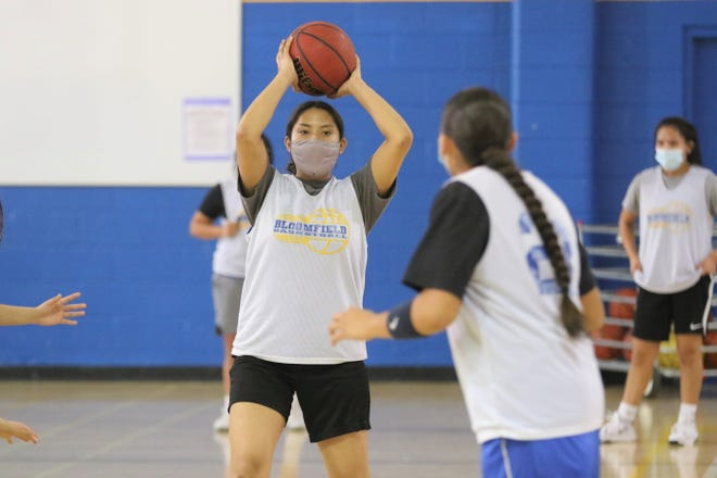 Jerona Murphy passes the ball to Danielle Johnson (23) during the Bloomfield Lady Bobcats' first day of basketball practice on Monday, March 22, 2021, at BHS's north gym.