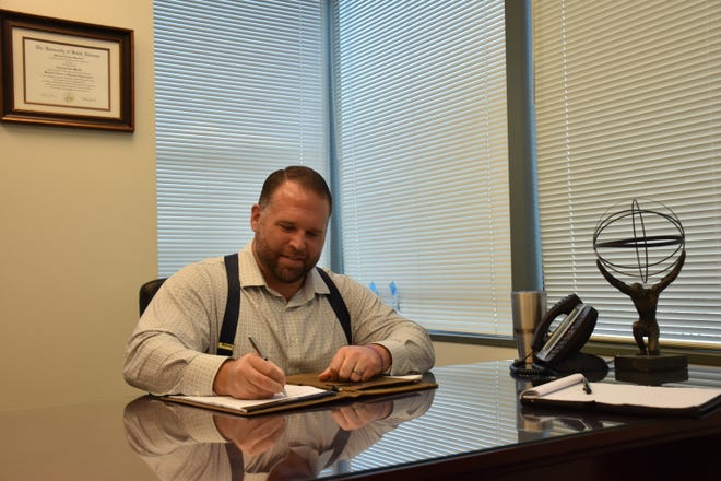 Andrew Martin, founder and president of Atlas Financial Strategies, smiles Monday while discussing his decision to pay for six catalytic converters stolen from the nonprofit Santa Rosa Transportation.