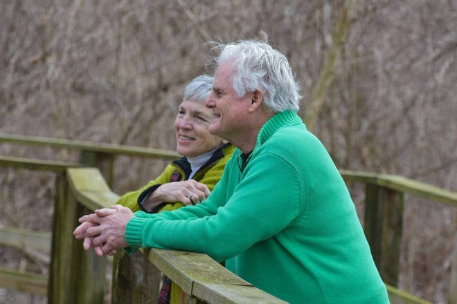 Joan Reidy and Terry Callahan of Lorain stop to enjoy the view on the boardwalk at Magee Marsh Wildlife Area on March 10.