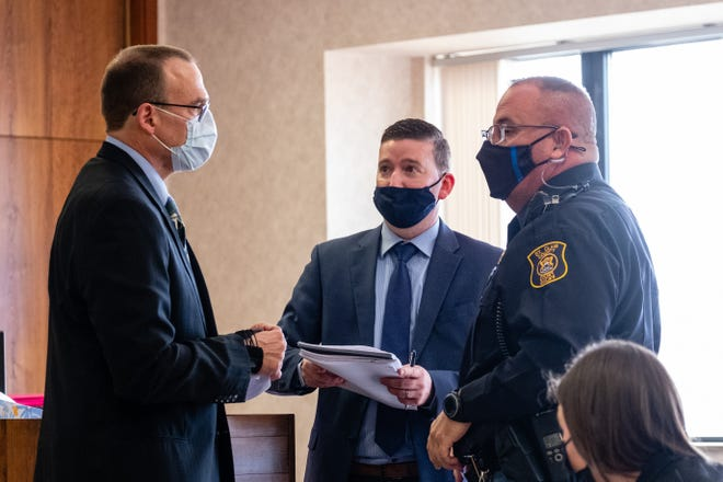 Michael Barna, left, prepares to be lead out of Circuit Court Judge Dan Damman's courtroom after his sentencing hearing Monday, March 22, 2021, in the St. Clair County Courthouse in Port Huron. Barna was sentenced on multiple charges for setting off explosive devices inside McLaren Port Huron last month.