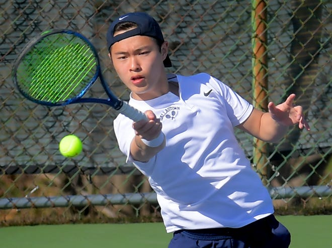 Dallastown's Daniel Wu returns against Northeastern's Evan Gibbs during tennis action at Dallastown Monday, March 22, 2021. Bill Kalina photo
