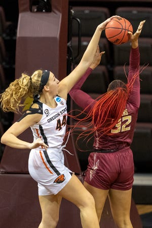 Oregon State's Taylor Jones (44) blocks Florida State forward Valencia Myers (32) during the first half of a college basketball game in the first round of the women's NCAA tournament at the University Events Center in San Marcos, Texas, Sunday, March 21, 2021.