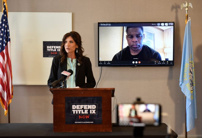 South Dakota Gov. Kristi Noem announces a new coalition, Defend Title IX Now, at the Hilton Garden Inn in Downtown Sioux Falls on Monday, March 22, 2021. Former NFL running back Herschel Walker spoke in support.