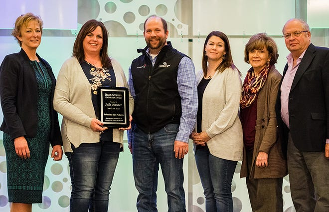 Julie Maurer, Newton, Wis., holding plaque, was honored with the 2021 PDPW Dean Strauss Memorial Award. The honor was presented March 18 during the PDPW Business Conference. Joining her from left are, l-r: Shelly Mayer, PDPW Executive Director, Strauss's brother, wife and parents: Darin Strauss, Kris Strauss, and Sandy and Ed Strauss.