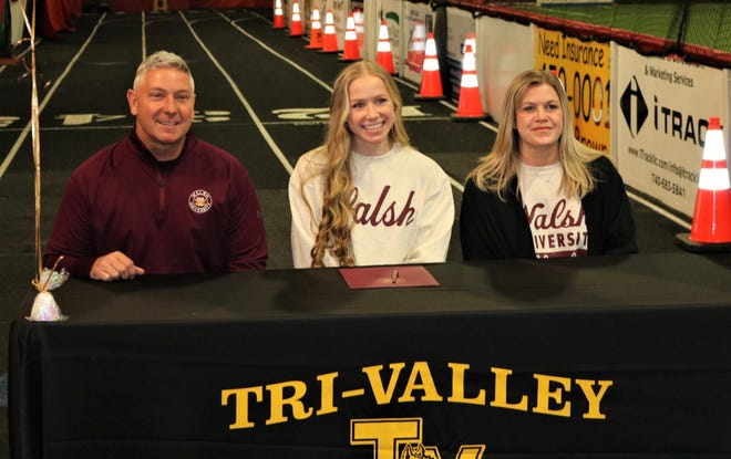 Tri-Valley senior Claire Martin (middle) signed her letter of intent last week to compete in track and field for Division II Walsh University. Also pictured are her parents, father, Eric, and mother, Jen.