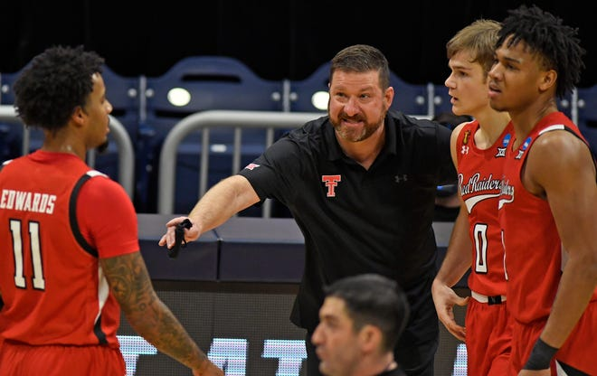 Coach Chris Beard and the Red Raiders fell to Arkansas in the closing seconds Sunday.