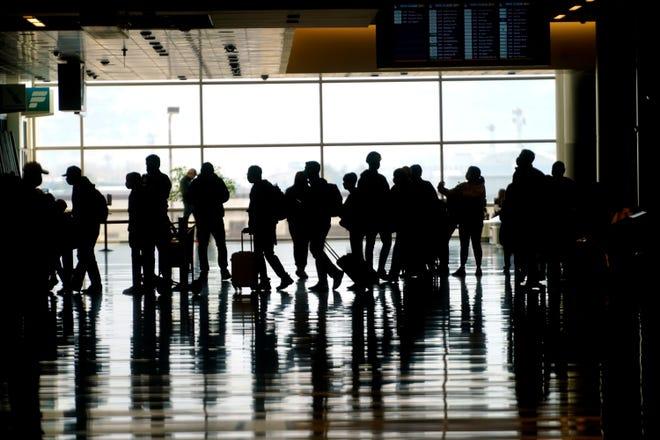 Travelers walk through the Salt Lake City International Airport Wednesday, March 17, 2021, in Salt Lake City, Utah.
