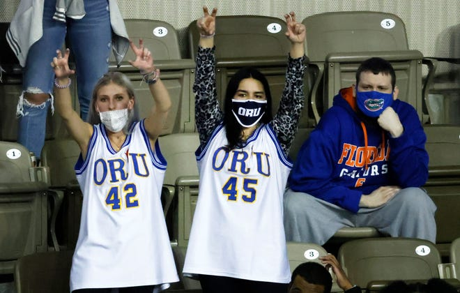 Oral Roberts fans react after defeating Florida 81-78 during the second round of the 2021 men's NCAA Tournament.