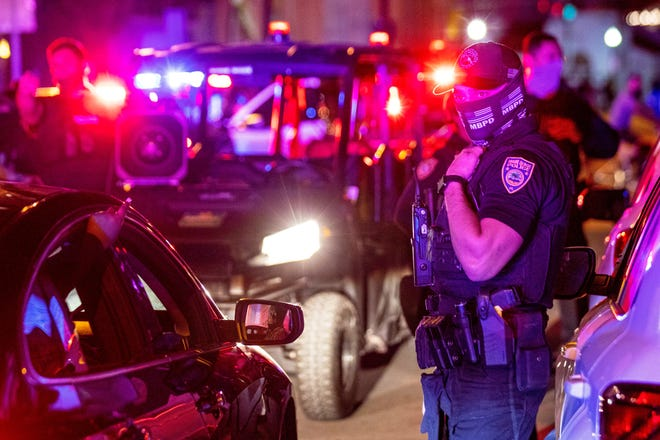 Miami Beach Police arrive on the scene to disperse a crowd that formed near Seventh Street and Alton Road, after crowds were sent away from Ocean Drive in Miami Beach, Fla., on, March 21, 2021.