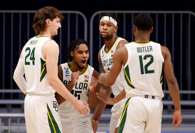 Davion Mitchell of Baylor reacts with his teammates during the first half against Wisconsin in their second-round game at Hinkle Fieldhouse.
