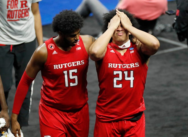 Rutgers Scarlet Knights center Myles Johnson (15) consoles teammate Ron Harper Jr. (24) after a loss to Houston during the second round of the 2021 NCAA Tournament on Sunday, March 21, 2021, at Lucas Oil Stadium in Indianapolis, Ind.