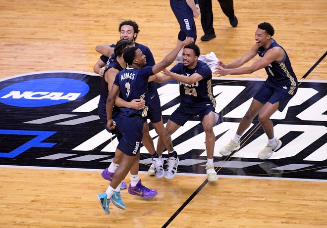 Oral Roberts Golden Eagles celebrate their 81-78 victory over the Florida Gators during the second round of the 2021 NCAA Tournament on Sunday, March 21, 2021, at Indiana Farmers Coliseum in Indianapolis, Ind.
