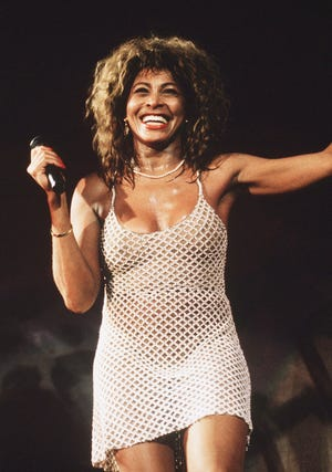 Tina Turner on stage at Wembley Stadium in London in 1990.