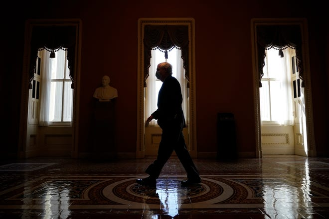 Senate Minority Leader Mitch McConnell, R-Ky., walks to his office after speaking on the Senate floor at the U.S. Capitol on Monday.