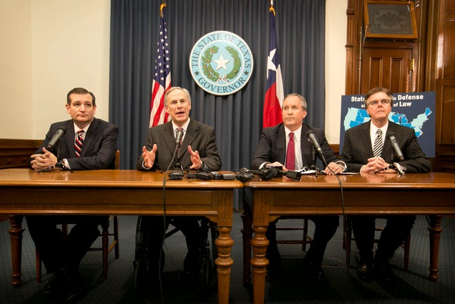 In this file photo, left to right, Sen. Ted Cruz, Gov. Greg Abbott, Attorney General Ken Paxton and Lt. Gov. Dan Patrick talk about immigration at a news conference in 2015.