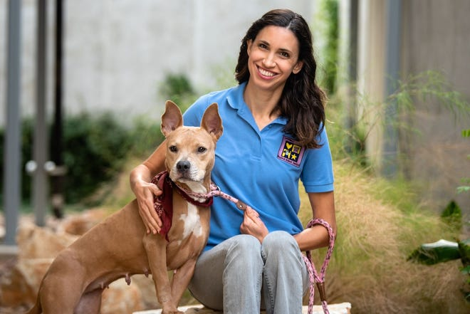 Misty Valenta, the animal services director for the Williamson County Regional Animal Shelter, poses with Diva.