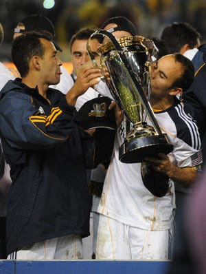 Los Angeles Galaxy forward Landon Donovan kisses the MLS Cup after the club won the 2011 championship game 1-0 over the Houston Dynamo. The Galaxy have appeared in a league-high nine championship games.