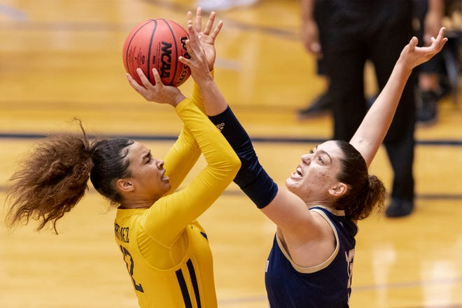 West Virginia forward Esmery Martinez (12) is defended by Georgia Tech forward Lorela Cubaj during the first half of a college basketball game in the second round of the women's NCAA tournament at the University of Texas at San Antonio Convocation Center in San Antonio, Tuesday, March 23, 2021.(AP Photo/Stephen Spillman)