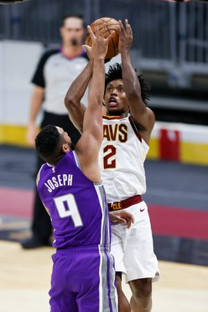 Cavaliers guard Collin Sexton (2) shoots over Sacramento Kings' Cory Joseph (9) in the first half of the Kings' 119-105 win Monday night in Cleveland. [Ron Schwane/Associated Press]