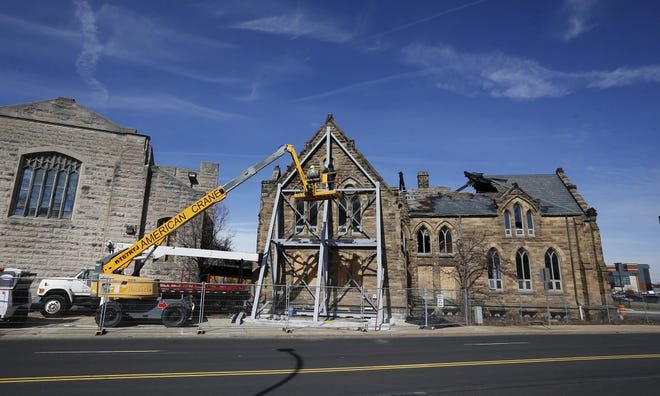 A crew from Quality Masonry Co. in Marion stabilizes the structure of the former St. Paul's Episcopal Church and former University of Akron Ballet Center on Feb. 28, 2019. The building was damaged in a 2018 fire.