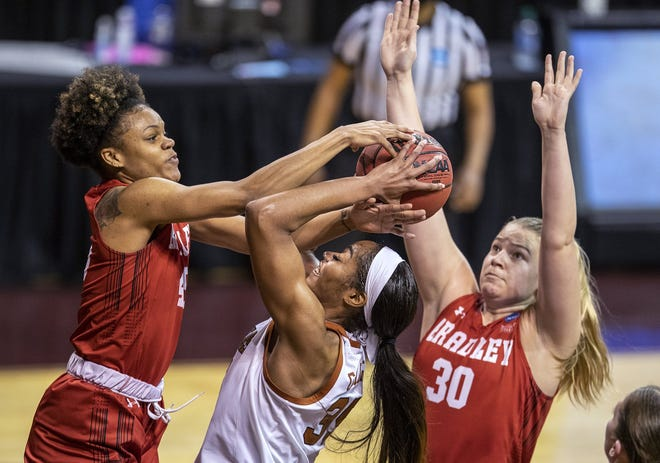 Texas forward Charli Collier battles for a rebound with Bradley forwards Nyjah White and Emily Marsh during the Longhorns' 81-62 first-round win in the NCAA Tournament at Strahan Arena in San Marcos. Collier scored 23 points to lead Texas.