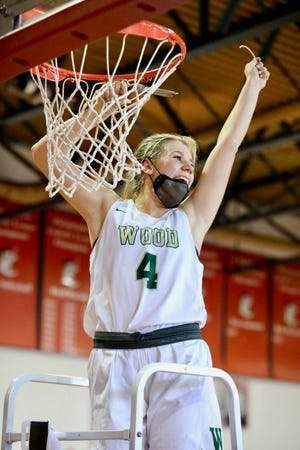 Archbishop Wood senior Kaitlyn Orihel cuts down the nets after Wood defeated Cardinal O'Hara to win the PCL championship. She is a Villanova recruit and the all-time scorer in Archbishop Wood history with 1,437 career points.