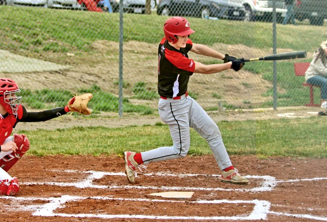 Sophomore leadoff hitter Griff Bonderer of the 2021 Chillicothe (Mo.) HS baseball Hornets drives a second-inning pitch back up the middle for a 2-runs single that delivered the go-ahead and ultimately-decisive runs of Monday's 3-2 CHS victory at Lawson.