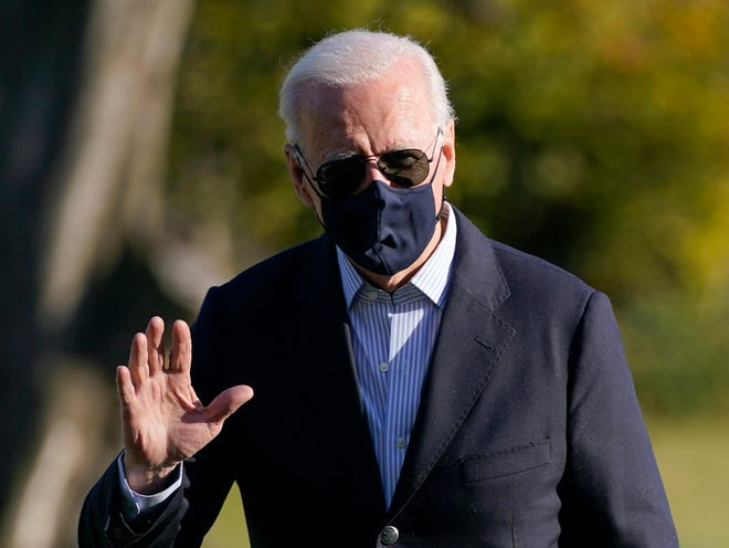 President Joe Biden walks on the South Lawn of the White House in Washington, Sunday, March 21, 2021, after stepping off Marine One, returning from a weekend visit to Camp David.