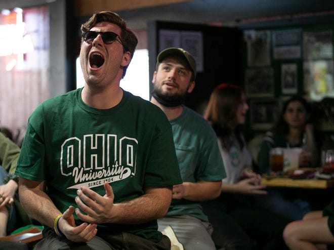 Alec, a senior at Ohio University, yells while watching the Ohio basketball game versus Creighton in the second round of the March Madness tournament from Lucky's Sports Tavern in Athens Monday.