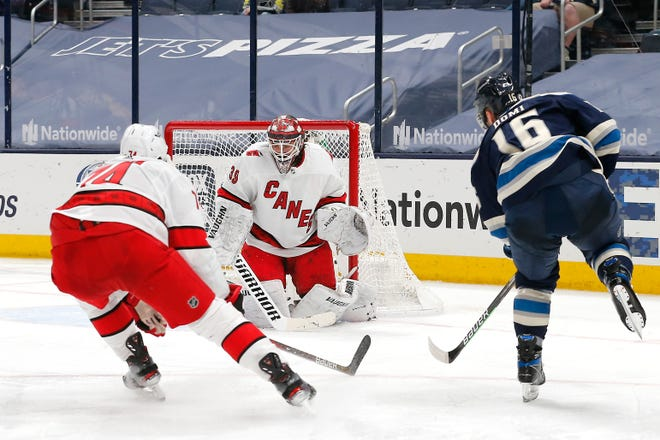Carolina goaltender Alex Nedelijkovic (39) makes a save on a shot by Blue Jackets forward Max Domi (16) during the third period of Monday's 3-0 win by the Hurricanes. The Jackets had only 19 shots on goal in the game.