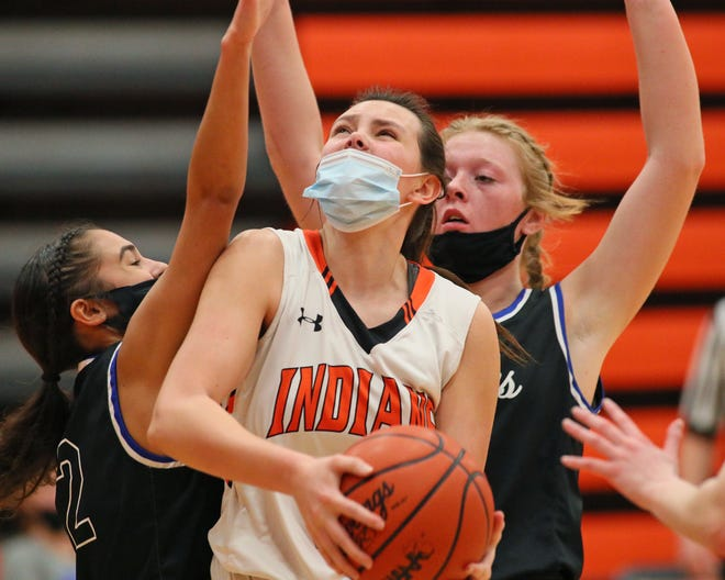 Tecumseh's Jaden Benschoter goes up for a shot during Monday's game against Adrian.