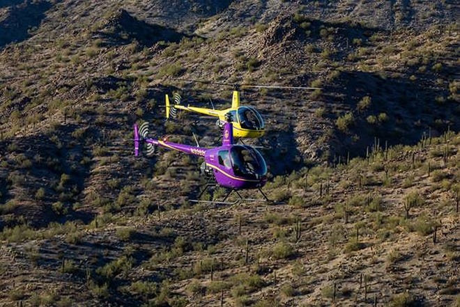 Two of the helicopters from the Dodge City Community College Flight Instructor program were out for a desert run in the San Tan Mountains, southeast of Phoenix, Ariz., on Feb. 26. The two helicopters, which are both Robinson R22s, were navigated by (purple) Angela Morrow, DCCC Adjunct Flight Instructor and (gold) Tim Brennan, DCCC Chief Flight Instructor. Currently,there are 37 students enrolled in the DCCC helicopter program, located in Chandler, Ariz.