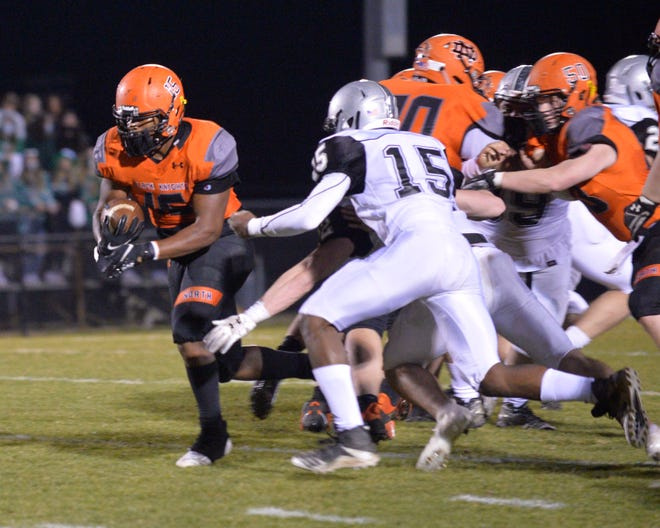 North Davidson's Jaylin Walser runs for yardage against Ledford. Walser and the Black Knights share first place with Oak Grove in the Central Carolina Conference. [Mike Duprez/The Dispatch]