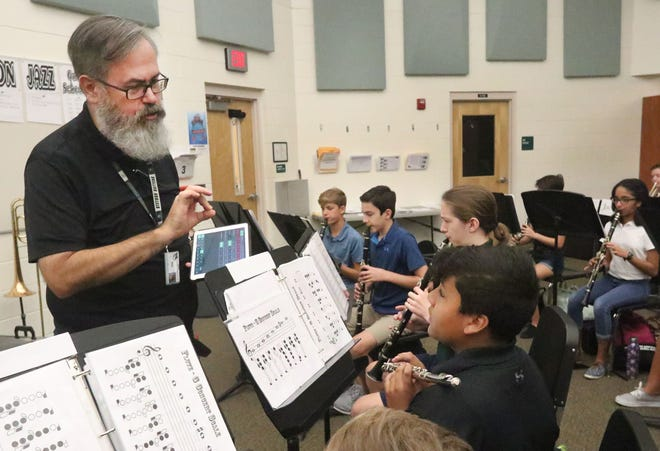 Ormond Beach Middle School band director Bill Guthrie, offers some instruction as he moves slowly through the band room, listening to the students, Thursday September 12, 2019 as they practice.