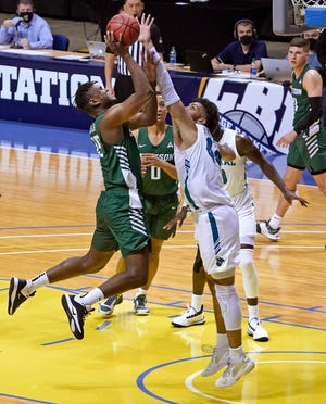 Stetson's Mahamadou Diawara goes up for a shot during Tuesday night's semifinal game at the Ocean Center.